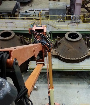 A robotic foundry system working in a plant